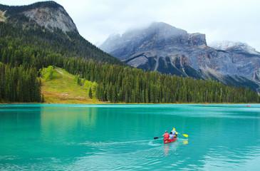 People conoeing on the Emerald Lake