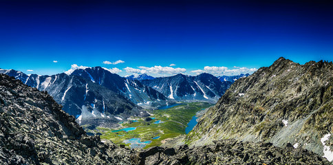 view on mountain range with valley, mountain lakes and river, national park in Altai republic, Siberia, Russia