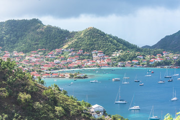 Terre-de-Haut Island in Guadeloupe, panorama of typical houses, the harbor in the bay with sailboats