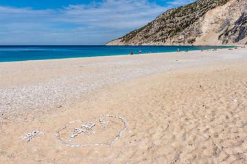 Amazing Myrtos beach with white sand and blue sea water on Kefalonia island. Greece.