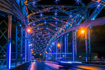 Russia. Bridges of Saint Petersburg. The bridge is decorated with light garlands. Bridge over the Neva River in St. Petersburg. New Year's decorations in Russia.