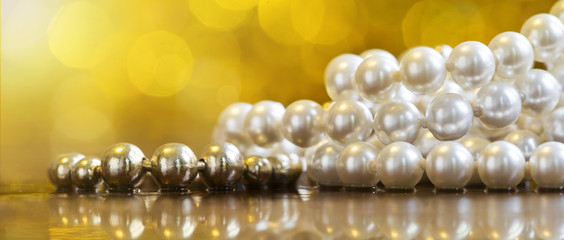 Web banner of beautiful white and golden pearls