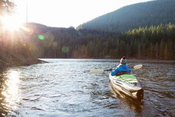 Girl Kayaking in a Lake. Taken in Buntzen Lake, Vancouver, British Columbia, Canada.
