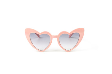 Pink heart shape sunglasses isolated