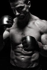 Mma fighter in front black background
