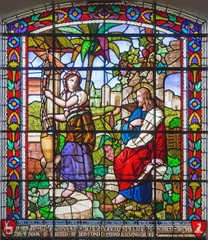 LONDON, GREAT BRITAIN - SEPTEMBER 15, 2017: The Jesus and Samaritans at well scene on the satined glass of St James's Church, Clerkenwell.