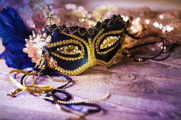 Venetian mask on wooden background