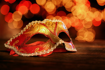 Traditional carnival mask over holiday lights
