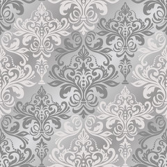 Seamless background of silver color in the style of baroque. Damask classic pattern.