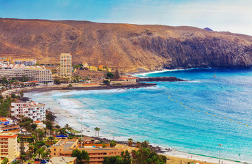 Aerial view over Los Cristianos beach and Adeje coastline in summer holiday, in Tenerife, Spain