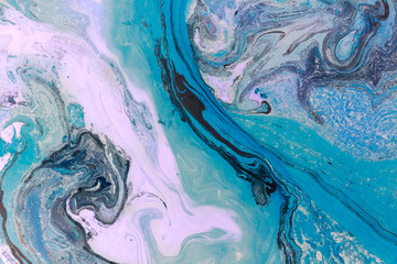 Creative ebru background with abstract painted waves. Beautiful liquid marbling texture. Contemporary art. Blue and violet colors.
