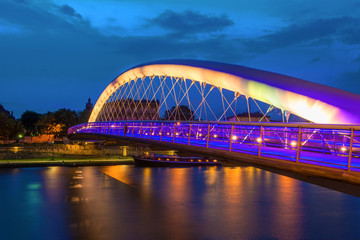 Bernatka footbridge over Vistula river in Krakow at night. Poland. Europe.