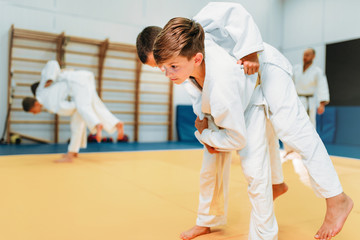 Kid judo, young fighters on training, self-defense