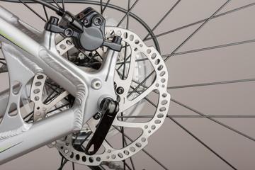Hydraulic rear disc brake of mountain bike, close up view, studio photo