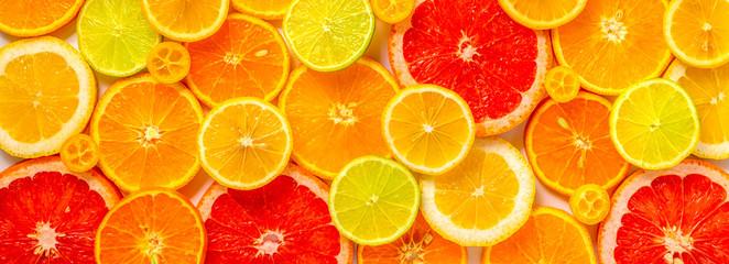 piękne świeże pokrojone mieszane owoce cytrusowe jak tło, koncepcja zdrowego odżywiania, diety, widok z góry