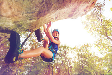 Rock climber training outdoors at sunny day
