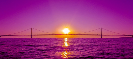 Sunset view and Mackinac Bridge in Michigan, USA.