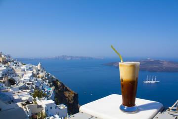 Greece Santorini island in Cyclades, coffee espresso freddo with wide sea of caldera in greek caffe