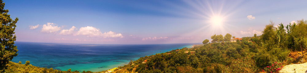 Panoramic view from Zakynthos island - Greece. Beautiful nature with sun, sea and mountains in a panoramic view from Zakynthos.