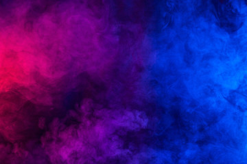 Violet and blue smoke or flame texture on a black background. Texture and abstract art