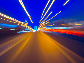 Speed motion on the neon glowing road at dark.