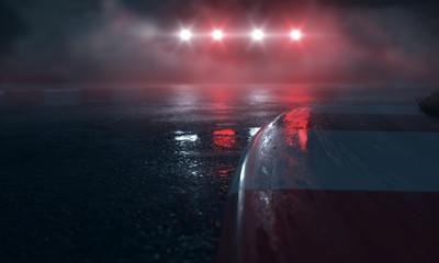 Mokry tor wyścigowy ze światłami