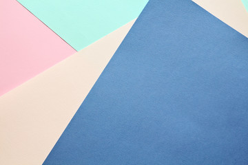 Abstract geometric multicolored watercolor paper background in soft pastel trend colors.