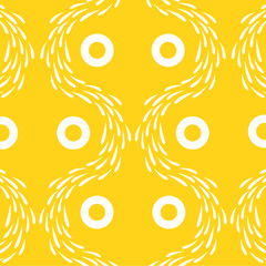 Yellow wallpaper with white pattern