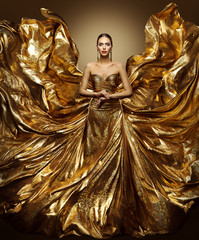 Gold Woman Flying Dress, Fashion Model in Waving Golden Gown, Fluttering Fabric Fly like Wings, Art Beauty Portrait