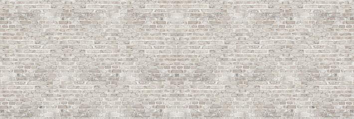 Ściana z cegieł rocznika obmycia biała tekstura dla projekta. Panoramiczne tło dla tekstu lub obrazu.