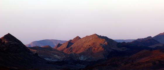 Mountains in the desert at sunrise sunset
