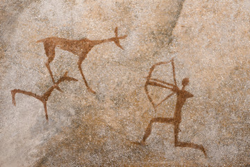 a drawing of an ancient hunt on the wall of a cave of ocher. history. archeology.