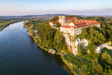 Benedictine monastery on the rocky cliff in Tyniec near Krakow, Poland, and Vistula River. Aerial view at sunset