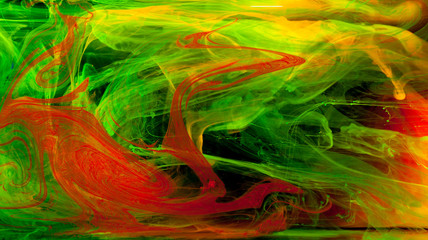 Abstraction of mix multicolored paints in water on a black background