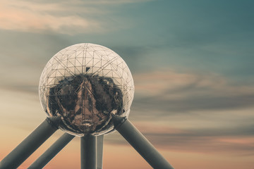 Atomium in brussels in front of beautiful sunset sky