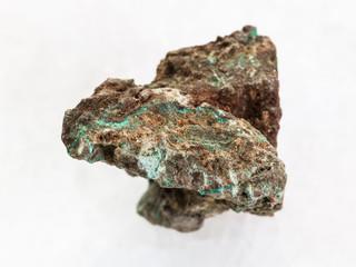 rough Malachite (copper ore) stone on white