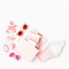Cosmetic products, sunglass, handbag on white background. Flat lay, top view. Fashion concept