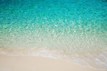 Wave of tropical sea beach on white sand