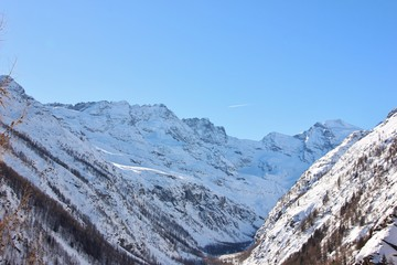 Valley of Valnontey, snowy landscape. Gran Paradiso peak, Aosta Valley, Gran Paradiso National Park, Italy
