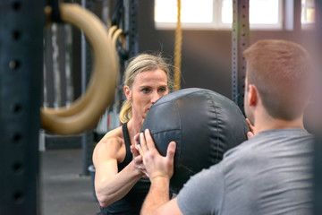 Man and woman working out with a medicine ball