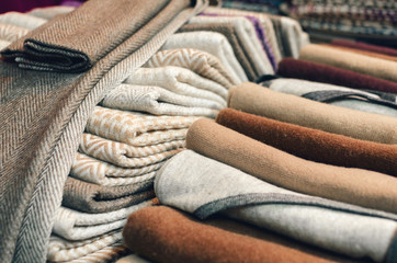 Cashmere wool scarves and wraps with lines and square decoration on a market stall