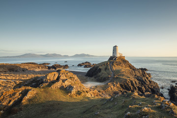 Victorian Lighthouse of Llanddwyn Island in Warm Sunset Light