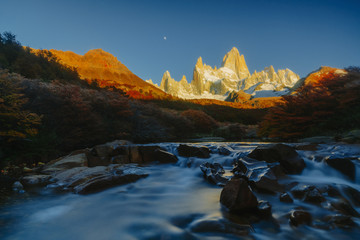 View of Mount Fitz Roy and the river in the National Park of Los Glaciares during sunrise. Autumn in Patagonia, the Argentine side