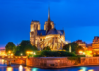 Ile de la Cite, Paris, France: Night view of Cathedrale Notre Dame de Paris or Our Lady of Paris, a beautiful cathedral and an important example of French Gothic architecture, sculpture and stained