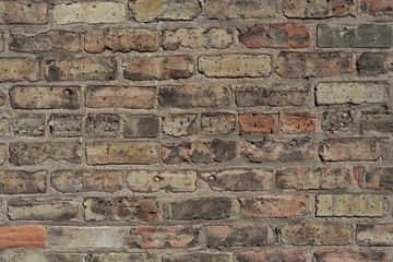 Larger old brick wall with several colors