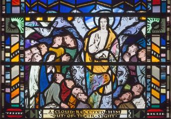 LONDON, GREAT BRITAIN - SEPTEMBER 16, 2017: The scene of Ascension of the Lord on the stained glass in church St Etheldreda by Charles Blakeman (1953 - 1953).