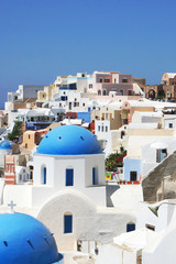 White house on the Santorini Island in Greece, cityscape wiht blue clear sky and white architecture