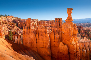 The Bryce Canyon National Park, Utah, United States, Red-yellow rocks in Bryce Canyon, Panorama of the mountain massif, A tourist place, A stone forest.