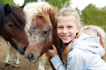 Pony and horsewoman - little girl and her best friend