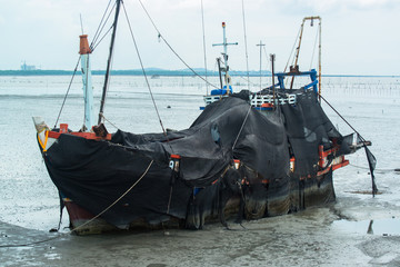 Fishing boat parked at sea port in Thailand.